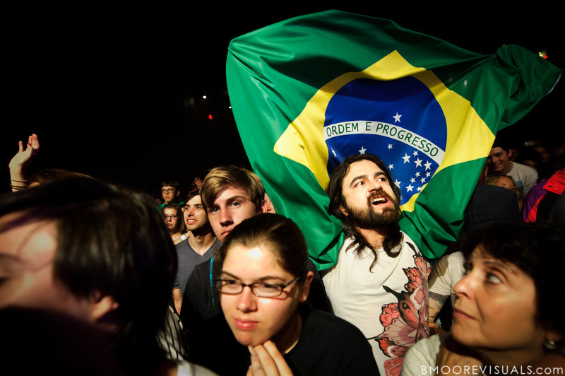 A fan proudly displays the Brazilian flag, the home country of CSS, as they perform at State Theatre in St. Petersburg, Florida on April 29, 2011