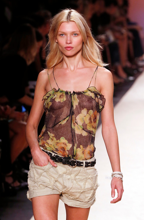 . A model wears a creation for Isabel Marant\'s ready-to-wear Spring/Summer 2014 fashion collection, presented in Paris, Friday, Sept.27, 2013. (AP Photo/Jacques Brinon)