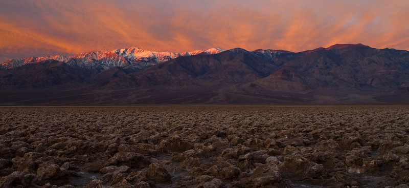 As luck would have it - the clouds were placed as if they were radiating out of the Panamint mountains. At the right morning hour the light of the sun lit them up with the most wondrous tinge of orange. The rest of the valley is still pretty dark.