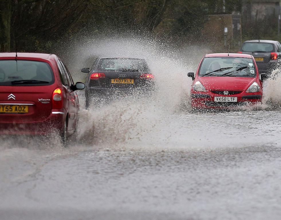 . Motorists tackle a flash flood near Tewkesbury at the confluence of the River Severn and the River Avon on December 24, 2012 in England. Forecasters have predicted more rain to sweep across the country causing flash flooding over the coming days.  The South West of England has been badly affected causing major disruption to the rail network delaying journeys for people making their way home for Christmas.  (Photo by Christopher Furlong/Getty Images)