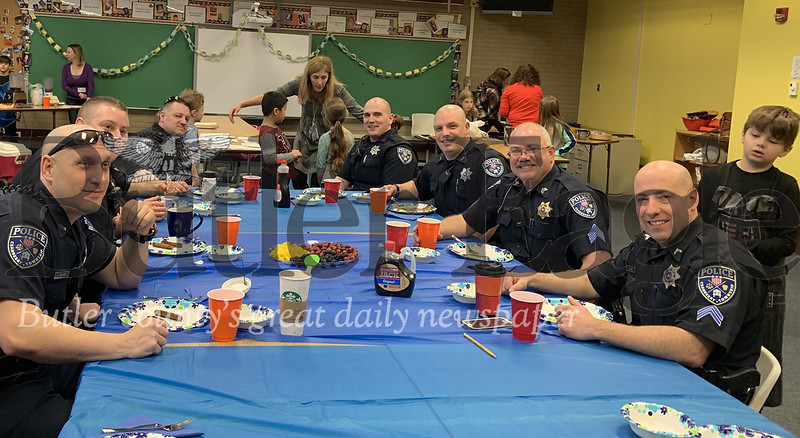 Cranberry Township police officers smile as Rowan Elementary third grade students serve them breakfast Wednesday morning. Photos by Alexandria Mansfield.