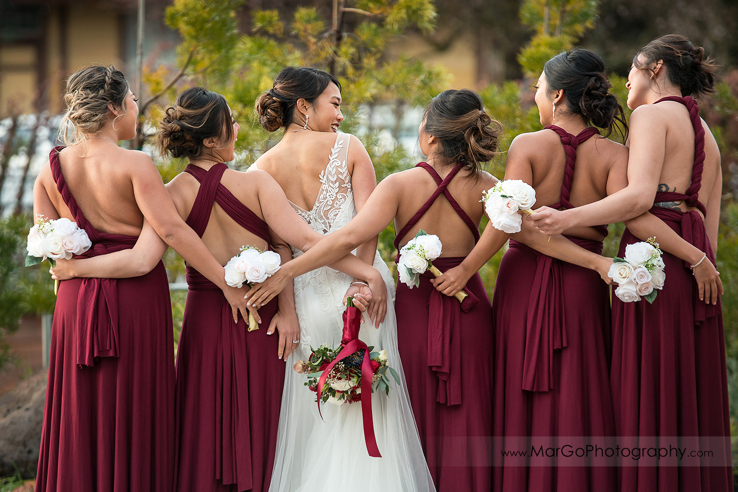 bride and bridesmaids with wedding bouquets in the back at Sunol's Casa Bella