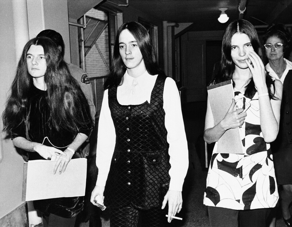 ". Susan Atkins, center, is flanked by two other members of Charles Manson\'s ""family\"" as she returned to court for a third day of testimony, Feb. 11, 1971 in Los Angeles. At left is Patricia Krenwinkel and at right is Leslie Van Houten. Ms. Atkins testified she is \""but a reflection\"" of Manson\'s love.  All three women and Manson have been found guilty of murdering actress Sharon Tate, and others. The jury now is determining their punishment. (AP Photo)"