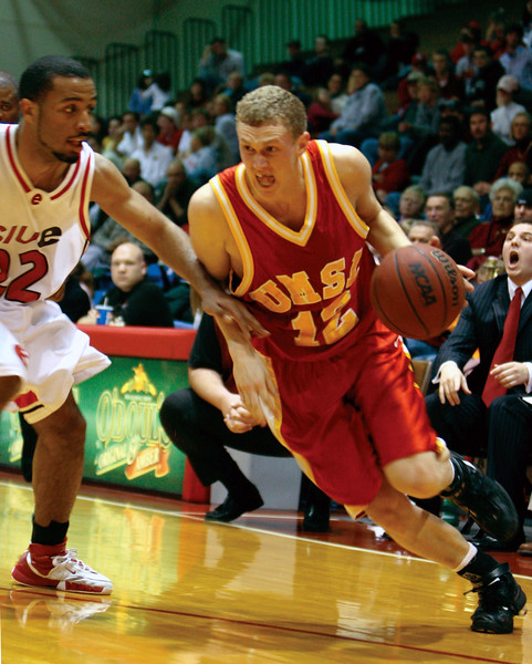 Brett Ledbetter tries to beat a SIU-Edwardsville player on the baseline Saturday night.