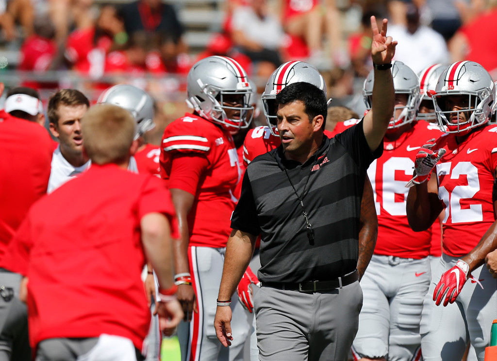. Ohio State acting head coach Ryan Day watches warm-ups before the start of their NCAA college football game against Oregon State Saturday, Sept. 1, 2018, in Columbus, Ohio. (AP Photo/Jay LaPrete)