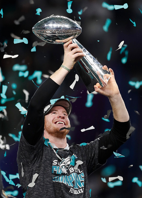 . Philadelphia Eagles\' Carson Wentz holds up the Vince Lombardi Trophy after the NFL Super Bowl 52 football game against the New England Patriots, Sunday, Feb. 4, 2018, in Minneapolis. The Eagles won 41-33. (AP Photo/Jeff Roberson)