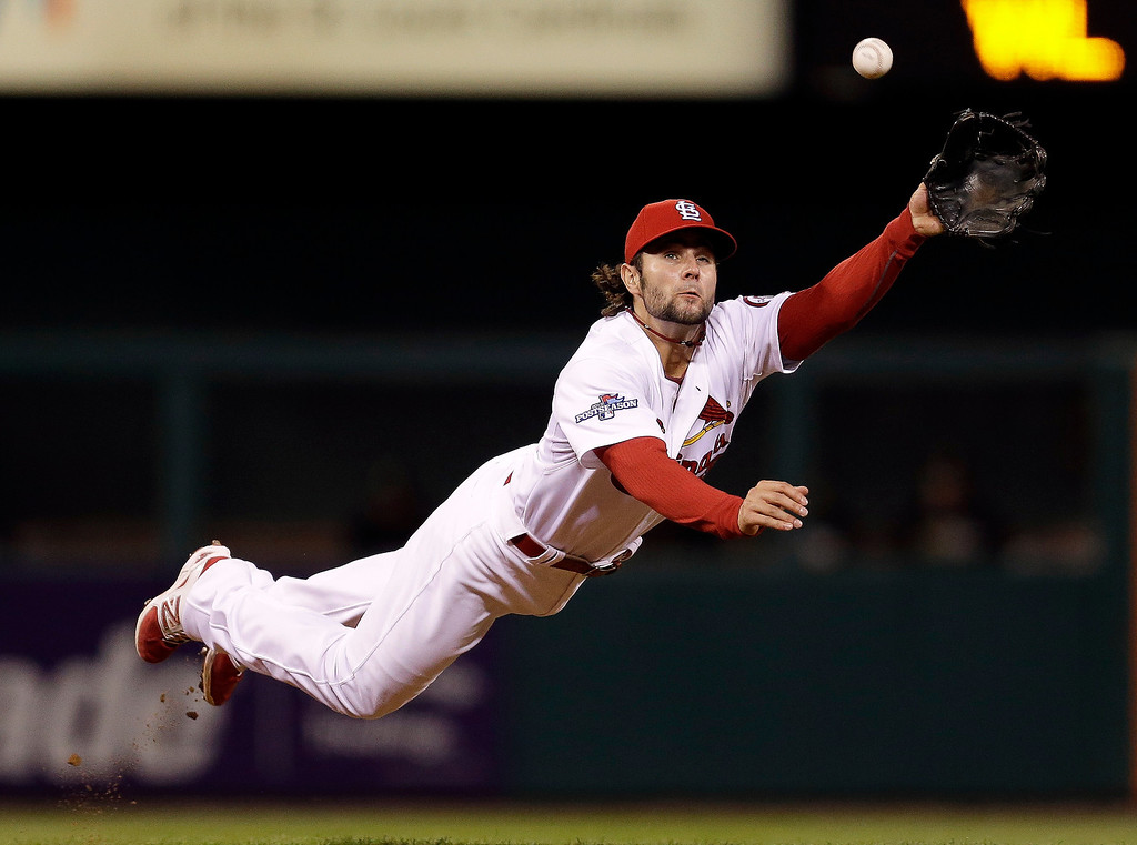 . St. Louis Cardinals shortstop Pete Kozma makes a diving catch of a ball hit by Pittsburgh Pirates\' Neil Walker in the fourth inning of Game 5 of a National League baseball division series on Wednesday, Oct. 9, 2013, in St. Louis. (AP Photo/Jeff Roberson)