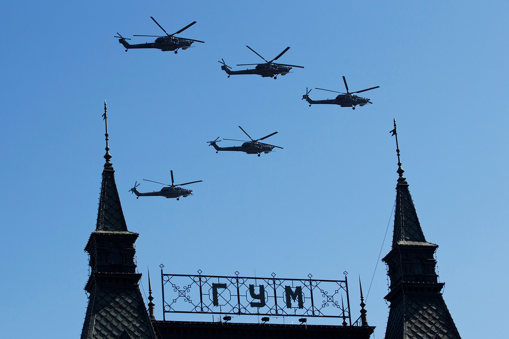 . Russian military helicopters Mi-28 fly during the Victory Day Parade in Red Square in Moscow, Russia, Friday, May 9, 2014.  (AP Photo/Pavel Golovkin)