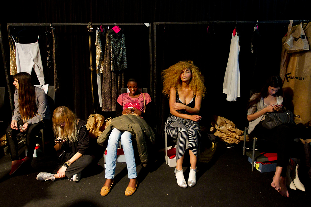 Description of . Models wait backstage prior to the show of Israeli designer Dorin Frankfurt at the Tel Aviv fashion week in Israel, Tuesday, Dec. 18, 2012. (AP Photo/Ariel Schalit)