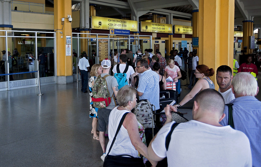 . British tourists queue up check-in at the Moi International Airport in Mombasa on May 16, 2014. Around 400 British tourists are being evacuated from the Kenyan resort of Mombasa after Britain stepped up travel warnings following a wave of terror attacks, travel agents said on May 16. Special charter flights were organized days after Britain, France, Australia and the United States issued new travel warnings for Kenya\'s coast following a wave of attacks and unrest linked to Islamist extremists. Tourism is a crucial part of Kenya\'s economy: according to the most recent figures from 2011, the sector directly or indirectly accounted for 14 percent of economic output and roughly 12 percent of the workforce. (Ivan Lieman/AFP/Getty Images)