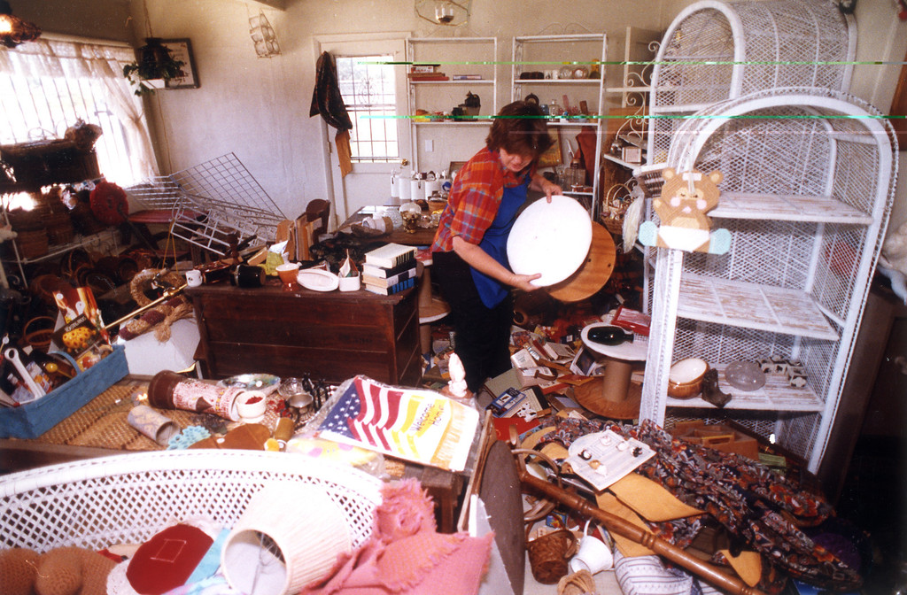 . June 28, 1992: Patty Browner cleans up her ravaged store, Backstreet West Second Chance Boutique, on Sunday in Yucca Valley.  Daily News file photo