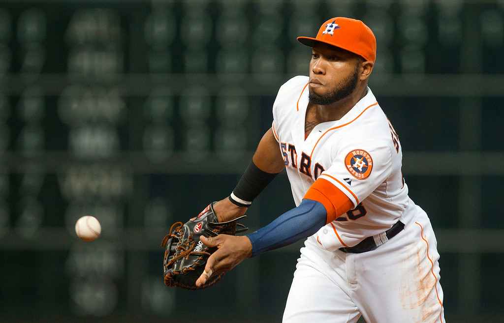 . Houston Astros\' Jon Singleton flips the ball to pitcher Brett Oberholtzer to get Detroit Tigers\' Victor Martinez out at first base in the fourth inning of a baseball game Saturday, June 28, 2014, in Houston. The Tigers won 4-3. (AP Photo/ The Courier, Jason Fochtman)