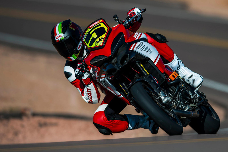 4/9: 2012 -The Ducati Multistrada 1200 S Pikes Peak wins for the 3rd year in succession. Photos courtesy of Ducati Chile The winning riders was Greg Tracy. The track record for bikes of 10 minutes, standing for something like 90 years was broken by Carlin Dunne with a time of 9'52'829 while Tracy also broke the 10 min barrier with a best time of 9'58'262.
