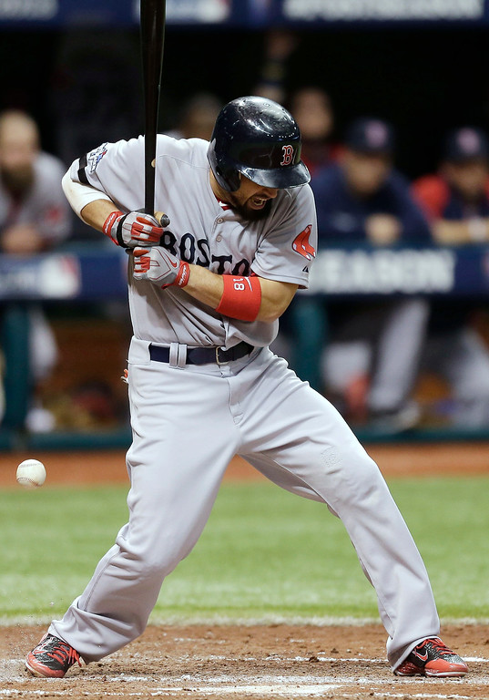 . Boston Red Sox\'s Shane Victorino is hit by pitch by Tampa Bay Rays reliever Alex Torres in the fifth inning in Game 4 of an American League baseball division series, Tuesday, Oct. 8, 2013, in St. Petersburg, Fla. (AP Photo/Chris O\'Meara)