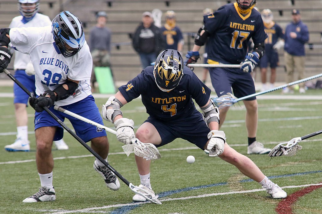 . Leominster High School boys lacrosse played Littleton High School today at Doyle Field in Leominster. Leominster\'s Joe Russo and Littleton\'s Daniel Angell keep their on a loose ball during  action the game. SENTINEL & ENTERPRISE/JOHN LOVE
