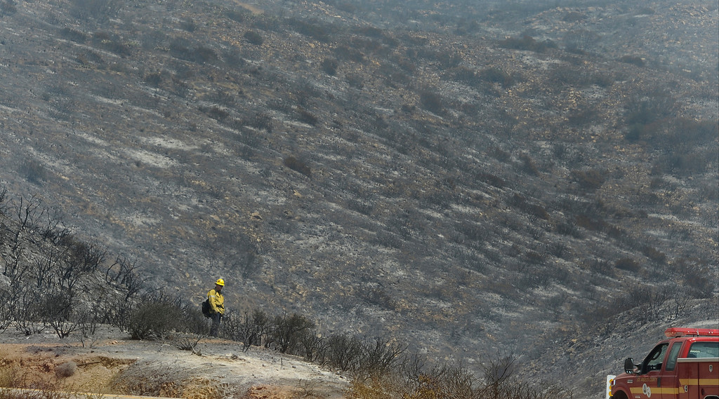 . Firefighter looks over the land during the second day of the Springs Fire in the mountain areas of Ventura County CA.  May 3, 2013. A fierce, wind-whipped brush fire spread on Friday along the California coast northwest of Los Angeles, threatening several thousand homes and a military base as more than 1,100 dwellings were ordered evacuated and a university campus was closed. May 2,2013. Ventura County California.  Photo by Gene Blevins/LA Daily News