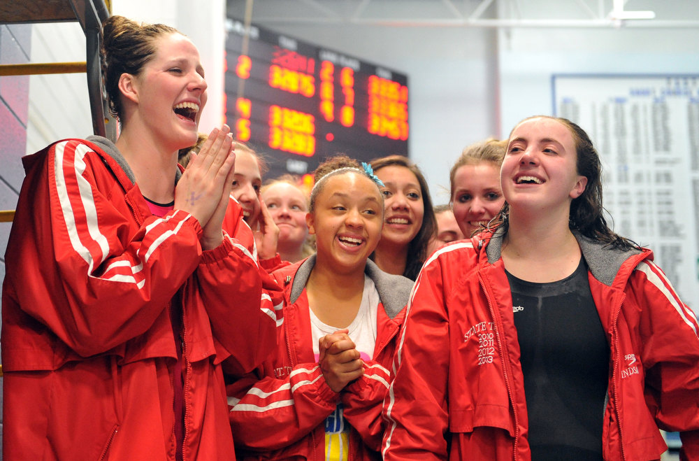 . FORT COLLINS, CO. - FEBRUARY 09: Missy Franklin, left, and Regis Jesuit High School swimmers react after winning the 5A state Championship on February 9, 2013 at Edora Pool Ice Center in Fort Collins, Colorado. (Photo By Hyoung Chang/The Denver Post)