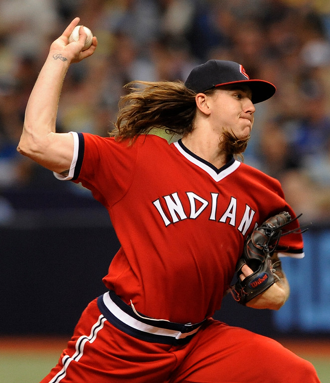 . Cleveland Indians starter Mike Clevinger pitches against the Tampa Bay Rays during the first inning of a baseball game, Saturday, Aug. 12, 2017, in St. Petersburg, Fla. Both teams are wearing throw-back jerseys. (AP Photo/Steve Nesius)