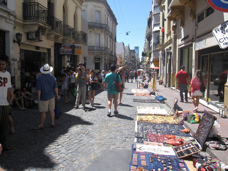 Sunday market in San Telmo. That's in Buenos Aires. In the southern hemisphere, a fictitious opposite land where toilets flush the other direction and cats chase dogs.