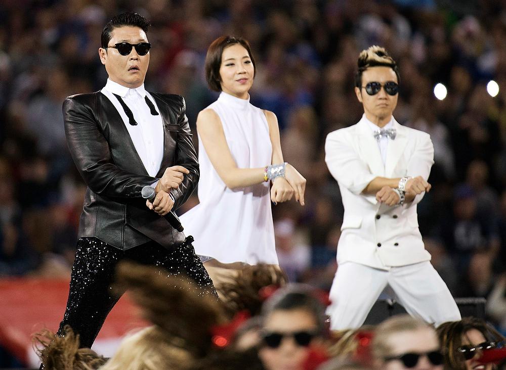 ". South Korean entertainer Psy, left, performs the song ""Gangnam Style\"" during halftime of an NFL football game between the Buffalo Bills and Seattle Seahawks, Sunday, Dec. 16, 2012, in Toronto. (AP Photo/The Canadian Press, Nathan Denette)"