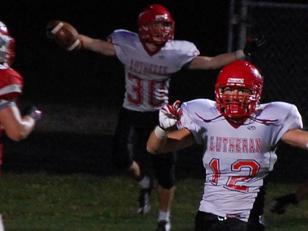 Lutheran West Longhorns pull off a 29-28 overtime win over Hawken on Sept 6, 2013.  Photo credit: Carol Mueller