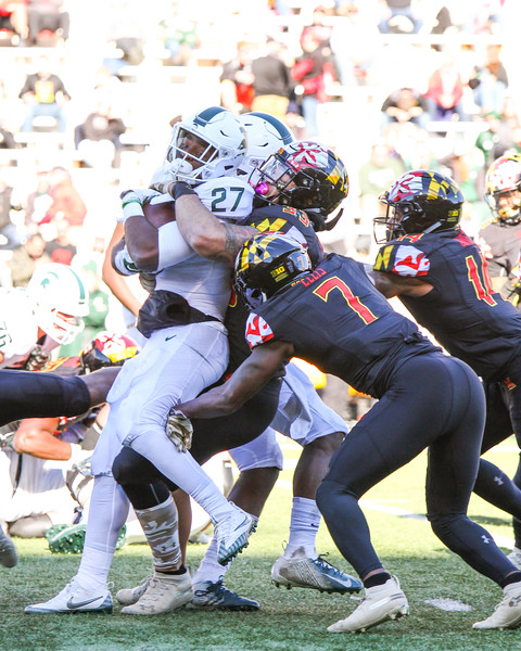 Michigan State RB #27 Weston Bridges fights for extra yards against Maryland defender