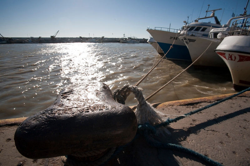 Bollard and moored fishing boats, Bonanza port, town of Sanlucar de Barrameda, province of Cadiz, Andalusia, Spain.