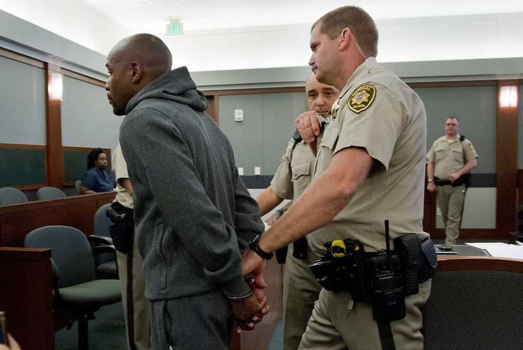 . Floyd Mayweather Jr., left, is led away by court marshall Ron Johnson, Friday, June 1, 2012, in Las Vegas, to begin a 90-day jail term for attacking his ex-girlfriend in September 2010 while two of their children watched. The undefeated five-division champion surrendered Friday before the judge who sentenced him in Decemberr, and then allowed him to remain free long enough to headline a May 5 fight. (AP Photo/Julie Jacobson)