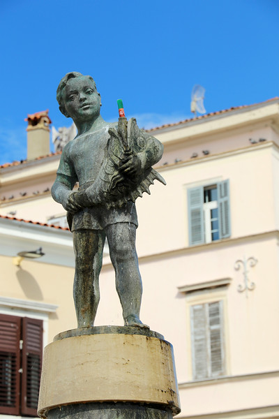 Bronze Boy statue in the town square commemorating the government-funded water system that finally brought running water to the Old Town in 1959...yes! Nineteen-59!