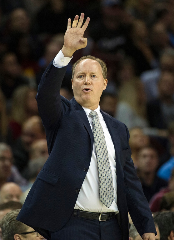 . Atlanta Hawks\' head coach Mike Budenholzer directs his team during the second half of an NBA basketball game against the Cleveland Cavaliers in Cleveland, Tuesday, Nov. 8, 2016. The Hawks won 110-106(AP Photo/Phil Long)