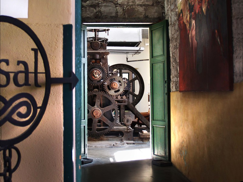 Fabrica la Aurora. The place for art and artists!! Once a fabric mill. he old machinery is still there.