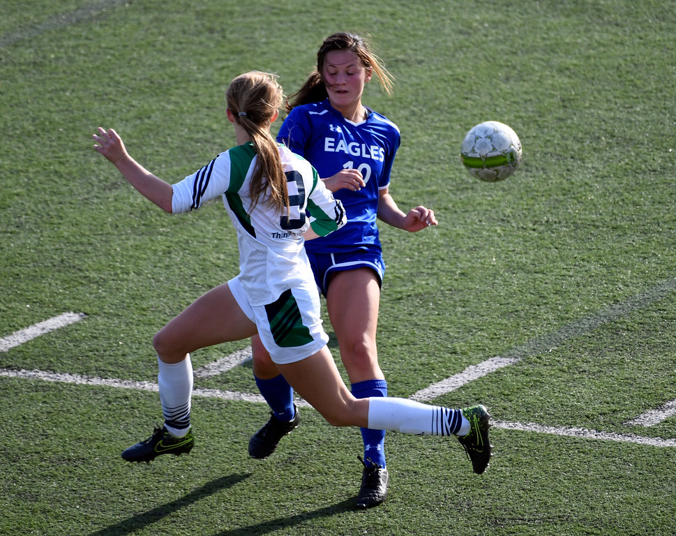 . HIGHLANDS RANCH, CO - MAY 18: ThunderRidge Maddie Duren (9) and Broomfield Cara Quinn (10) clash during the second half in girls quarterfinals May 18, 2016 at Shea Stadium. Broomfield defeated ThunderRidge 2-0. (Photo By John Leyba/The Denver Post)