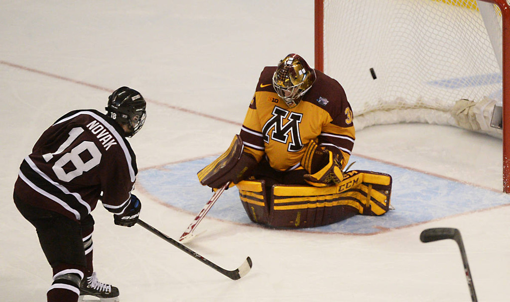. Union College junior forward Max Novak scores against Minnesota sophomore goalie Adam Wilcox in the third period of the NCAA Frozen Four Championship Game at the Wells Fargo Center in Philadelphia, Saturday, April 12, 2014. Union College beat the Gophers 7-4 to claim the national championship.  (Pioneer Press: John Autey)