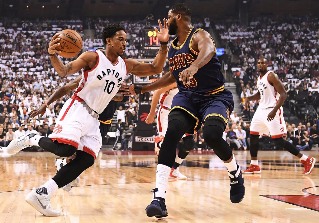 . Toronto Raptors guard DeMar DeRozan (10) drives against Cleveland Cavaliers center Tristan Thompson (13) during the first half of Game 3 of an NBA basketball second-round playoff series in Toronto on Friday, May 5, 2017. (Frank Gunn/The Canadian Press via AP)