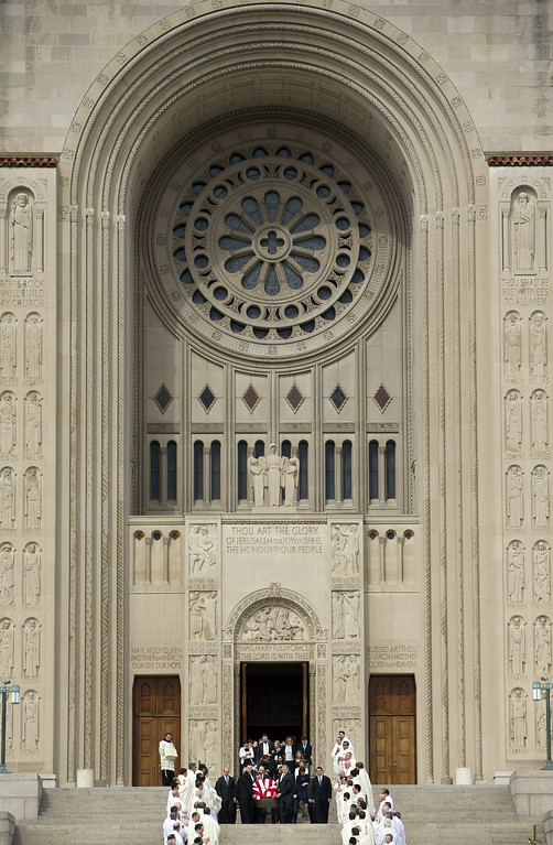 . The casket containing the body of the late Supreme Court Associate Justice Antonin Scalia leaves the Basilica of the National Shrine of the Immaculate Conception in Washington following funeral mass services, Saturday, Feb. 20, 2016. (AP Photo/Pablo Martinez Monsivais)