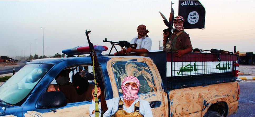 Description of . An image uploaded on June 14, 2014 on the jihadist website Welayat Salahuddin allegedly shows militants of the Islamic State of Iraq and the Levant (ISIL) riding in a captured vehicle left behind by Iraqi security forces at an unknown location in the Salaheddin province. A major offensive spearheaded by ISIL but also involving supporters of executed dictator Saddam Hussein has overrun all of one province and chunks of three others since it was launched on June 9. AFP PHOTO / HO / WELAYAT SALAHUDDIN === RESTRICTED TO EDITORIAL USE - MANDATORY CREDIT