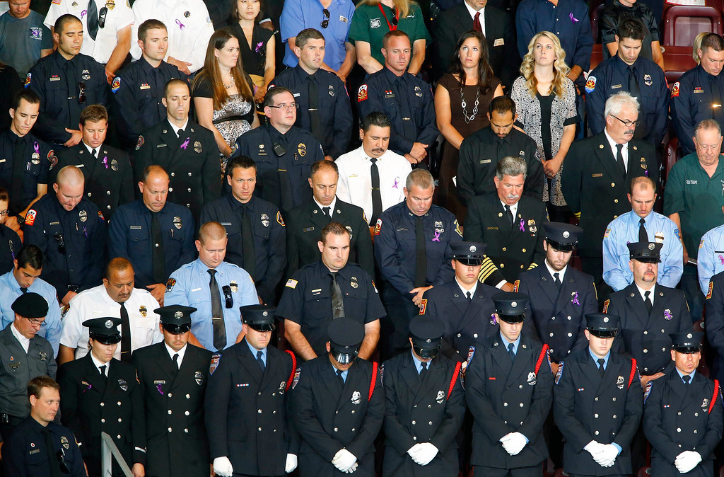 . Dignitaries, officials, family members and firefighters from across the country attend the memorial service for 19 Granite Mountain hotshot firefighters at Tim\'s Toyota Center in Prescott Valley, Arizona July 9, 2013.   REUTERS/David Kadlubowski/Pool