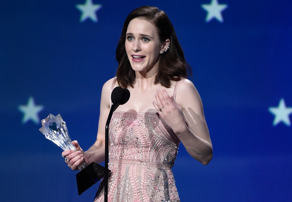 ". Rachel Brosnahan accepts the award for best actress in a comedy series for ""The Marvelous Mrs. Maisel\"" at the 23rd annual Critics\' Choice Awards at the Barker Hangar on Thursday, Jan. 11, 2018, in Santa Monica, Calif. (Photo by Chris Pizzello/Invision/AP)"