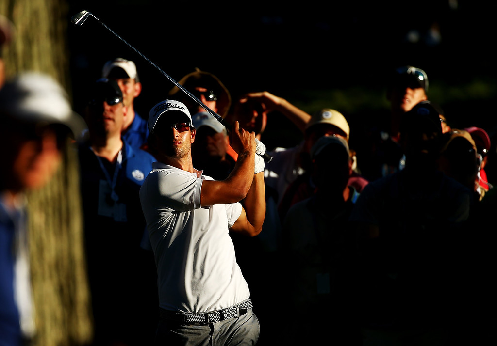 . ROCHESTER, NY - AUGUST 10: Adam Scott of Australia hits a shot from the rough on the 17th hole as a gallery of fans look on during the third round of the 95th PGA Championship on August 10, 2013 in Rochester, New York.  (Photo by Streeter Lecka/Getty Images)
