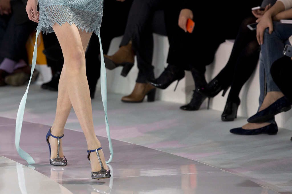 . A model presents a creation from the JEFEN collection by Chinese designer Frankie Xie during Fashion Week in Beijing, China, Saturday, Oct. 26, 2013. (AP Photo/Ng Han Guan)