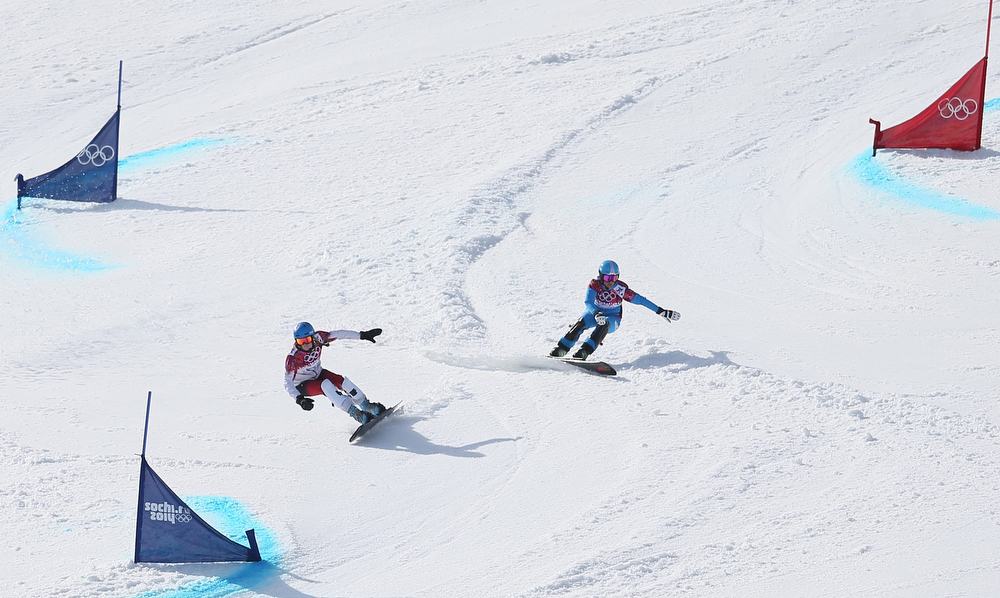 . Ina Meschik (R) of Austria competes against Marianne Leeson of Canada in the quarter final of the women\'s Snowboard Parallel Giant Slalom at Rosa Khutor Extreme Park at the Sochi 2014 Olympic Games, Krasnaya Polyana, Russia, 19 February 2014.  EPA/SERGEY ILNITSKY