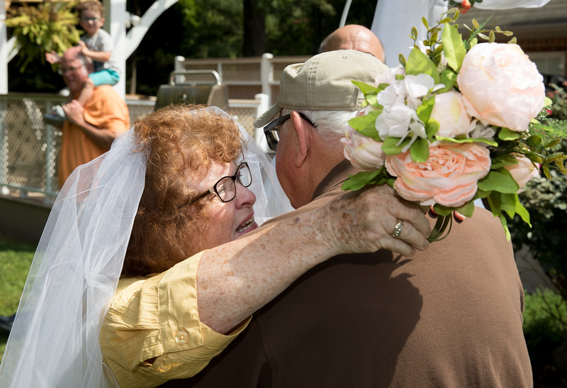 Mam and Badge Embracing at the Altar.jpg
