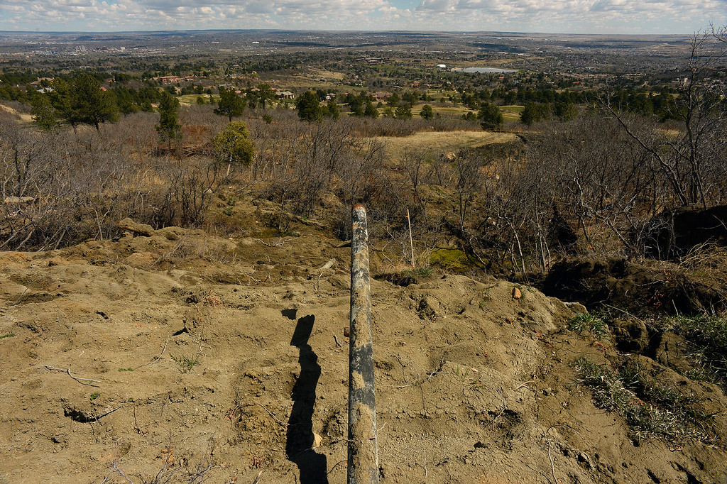 . A water pipe that recently fed water to the Broadmoor Mountain Golf Course and homes in the area was exposed and destroyed from a recent landslide above the golf course on April 11, 2016 in Colorado Springs, Colorado. The landslide is slowly creeping down towards homes and the golf course.  200 homeowners in Colorado Springs have applied for federal bailouts because their homes are being eaten up by collapsing expansive soil that is part of an ancient and massive landslide area.   It is a problem that city officials have known about since the mid-1990\'s when city planners approved developments on what geologists have called some of the most unstable geology on the front range.  (Photo by Helen H. Richardson/The Denver Post)