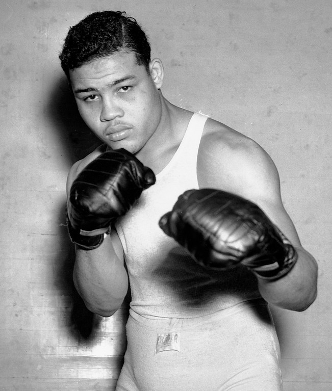 . Fighter Joe Louis, nicknamed the Brown Bomber, poses in his boxing apparel in Pompton Lakes, N.J. on Jan. 24, 1937. Louis achieved the world heavyweight title in June 1937 and held it until May 1949. (AP Photo)