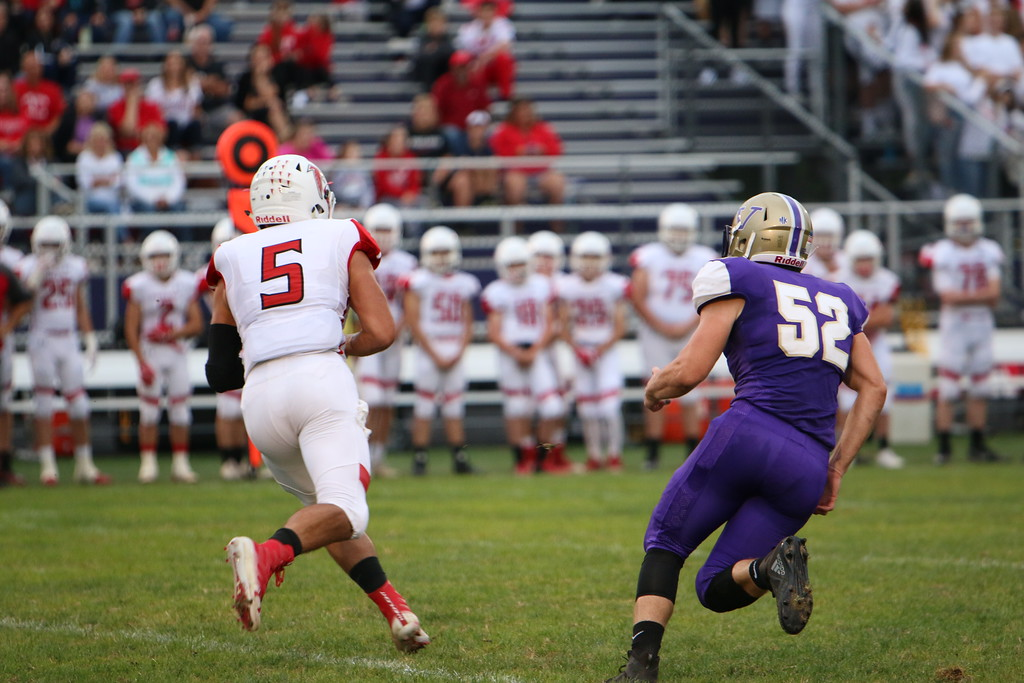 . Kyle Sooy - The Morning Journal<br> Firelands\' Blake Ruffner tries to escape the Vermilion defense on Sept. 6.