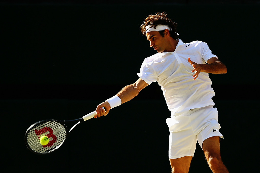 . Roger Federer of Switzerland plays a forehand return during the Gentlemen\'s Singles Final match against Novak Djokovic of Serbia on day thirteen of the Wimbledon Lawn Tennis Championships at the All England Lawn Tennis and Croquet Club on July 6, 2014 in London, England.  (Photo by Al Bello/Getty Images)