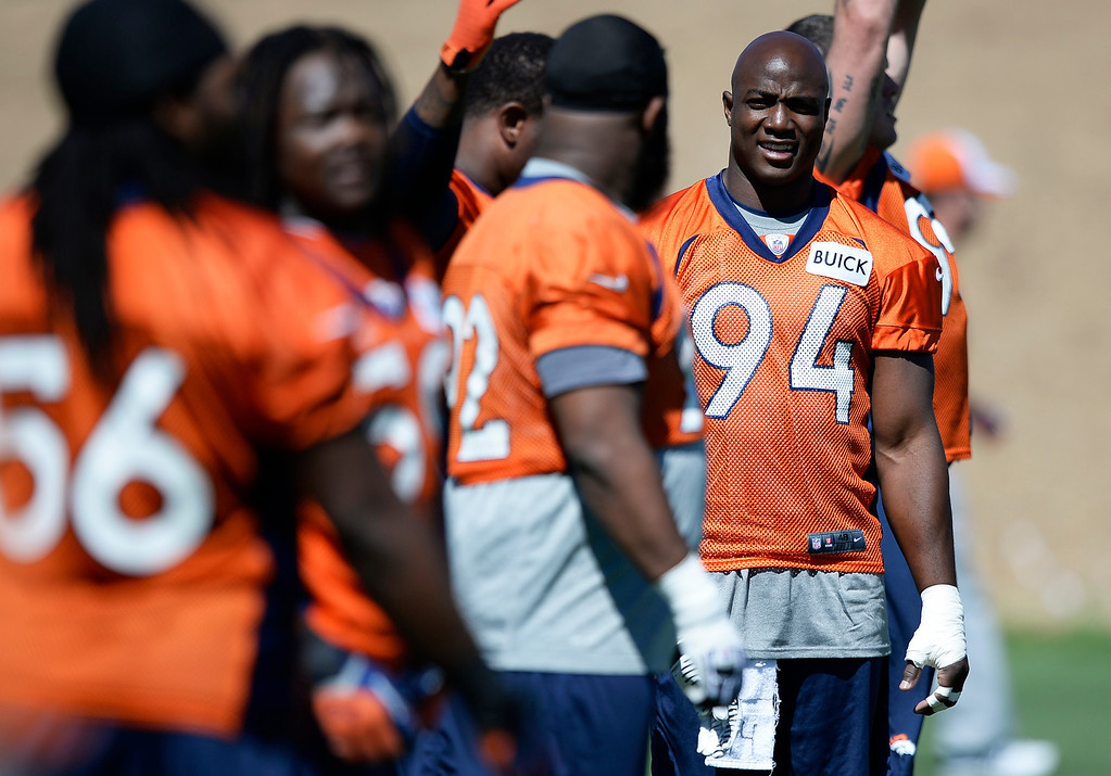 . Denver Broncos defensive end DeMarcus Ware (94) looks on during stretching at OTAs June 2, 2014 at Dove Valley. (Photo by John Leyba/The Denver Post)