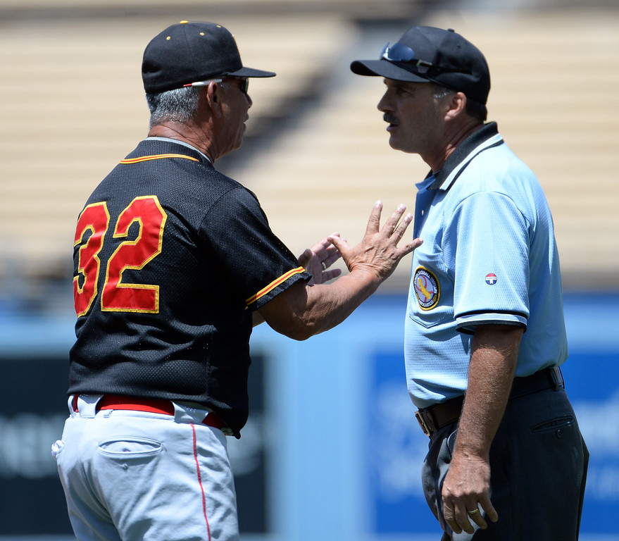. Palm Desert head coach Darol Salazar argues over a safe call at first base in the second inning of the CIF-SS Division 3 baseball championship against Bishop Amat at Dodger Stadium in Los Angeles on Friday, June 6, 2014. Bishop Amat won 4-3. 