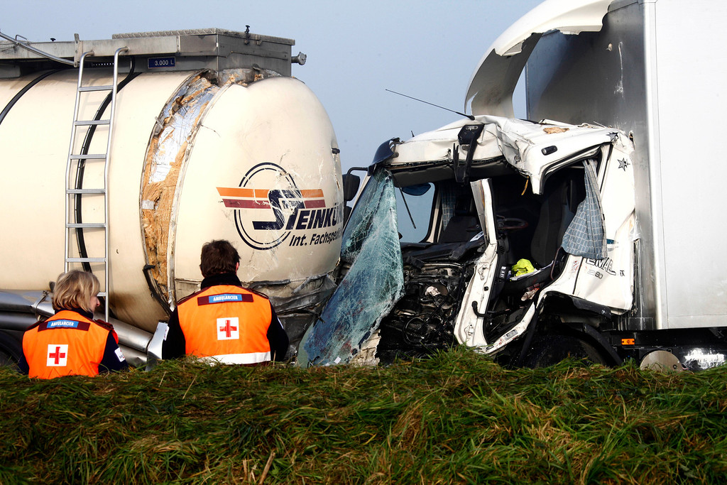 . Belgian paramedics stand at the scene of a pileup involving dozens of cars and trucks near Zonnebeke, Belgium, Tuesday, Dec. 3, 2013.  (AP Photo / Michel Spingler)