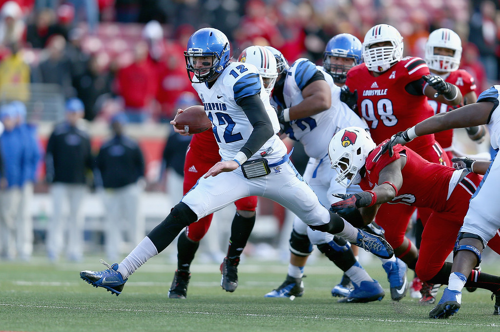 . LOUISVILLE, KY - NOVEMBER 23:  Paxton Lynch #12 of the Memphis Tigers runs with the ball during the game against the Louisville Cardinals at Papa John\'s Cardinal Stadium on November 23, 2013 in Louisville, Kentucky.  (Photo by Andy Lyons/Getty Images)